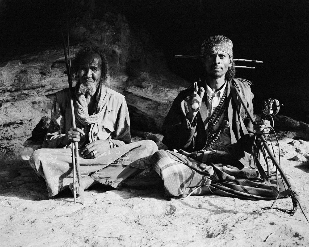 "Dire Sheikh Hussein: Sheikh Faisal & Tunaa Adyo inside Anagenyi cave. 4x5"" Black & White Film"