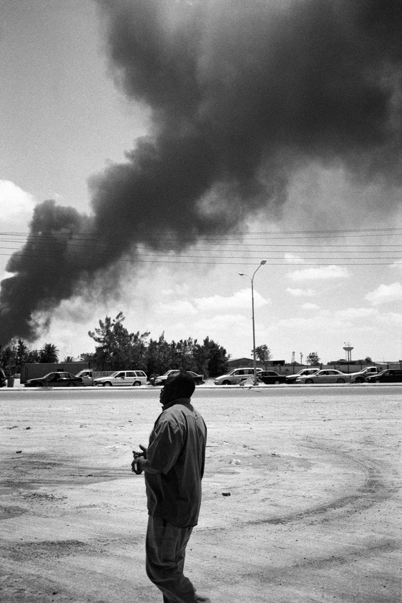 During the battle of Misrata (معركة مصراتة‎‎), fuel stock burning after being hit by a mortar